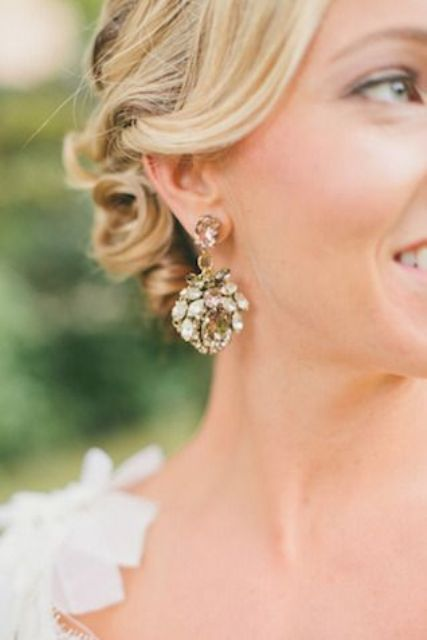 Picture Of statement earrings wedding trend ideas  20