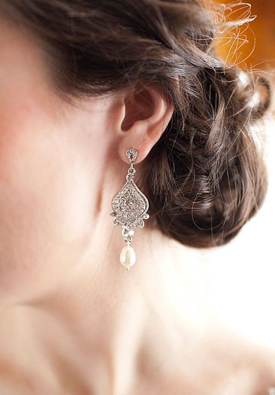 Picture Of statement earrings wedding trend ideas  27