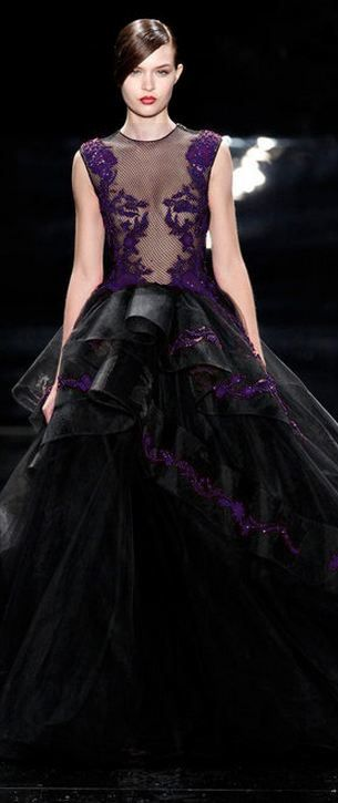 a breathtaking black and purple sleeveless wedding ballgown with a sheer bodice and lace appliques plus a layered ruffle skirt