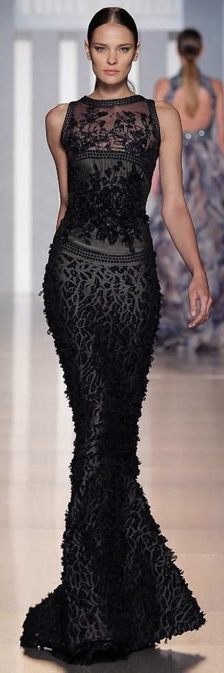 a black sleeveless sheath wedding dress with embroidery, beading and other detailing to create a Morticia Addamas look