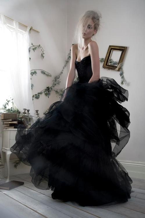 a black strapless wedding ballgown with an embellished bodice and a tiered ruffle skirt is a very glam and chic idea