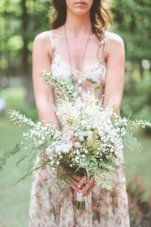 an airy spring woodland wedding bouquet of eucalyptus, ferns, baby's breath and herbs is a lovely idea