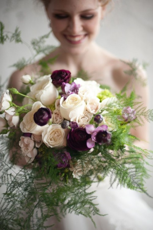 a bright wedding bouquet with purple and white blooms, with ferns is a beautiful option for a dramatic woodland bride