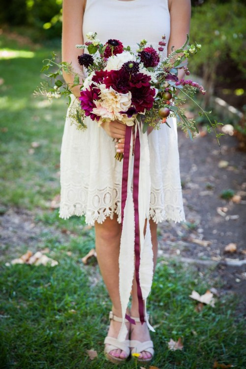 a bright fall wedding bouquet of blush and purple blooms, with apples and berries and greenery will fit a woodland bride, too
