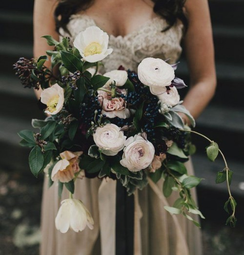 a catchy woodland wedding bouquet of white and blush blooms, lots of privet berries and foliage is a lovely idea for a garden or forest bride