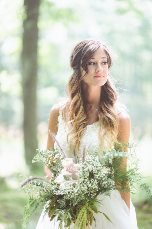 a chic wedding bouquet with white blooms of various types and ferns will fit a summer or spring bride