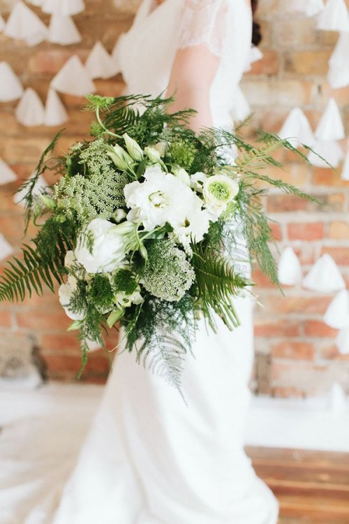 a beautiful wedding bouquet of white blooms and various kinds of greenery and ferns is great for a spring or summer bride