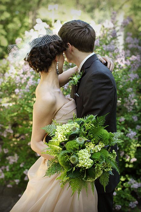 a green woodland wedding bouquet with much greenery and ferns, with berries and lotus and some green hydrangeas is a lovely idea