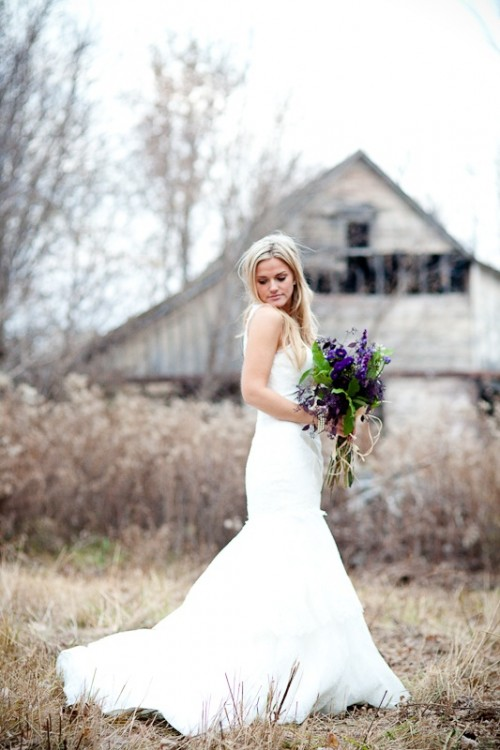 a plain mermaid wedding dress on straps with a train is a great idea for a modern barn bride