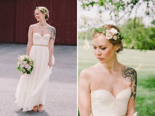 a simple strapless lace wedding dress with an embellished sash and a floral crown