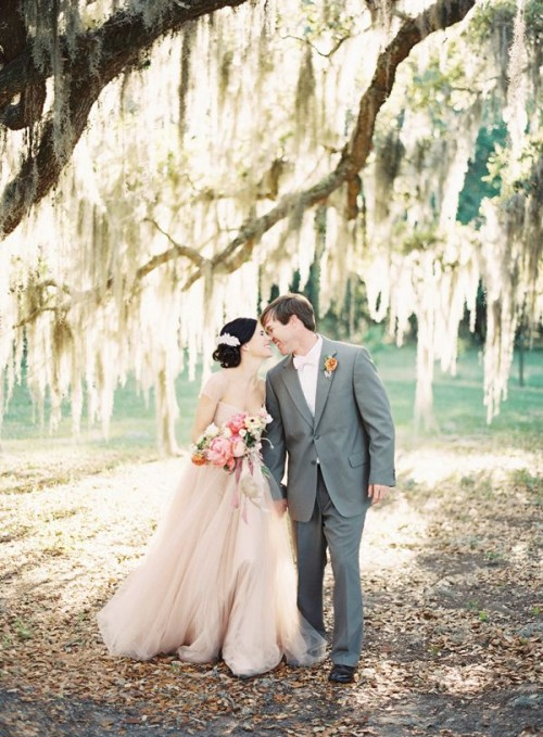 a blush A-line wedding dress with cap sleeves and a square cutout is a very romantic outfit idea for a barn bride