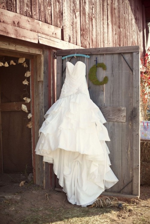a princess wedding gown with a strapless neckline,  a draped bodice and skirt and a train for a barn princess