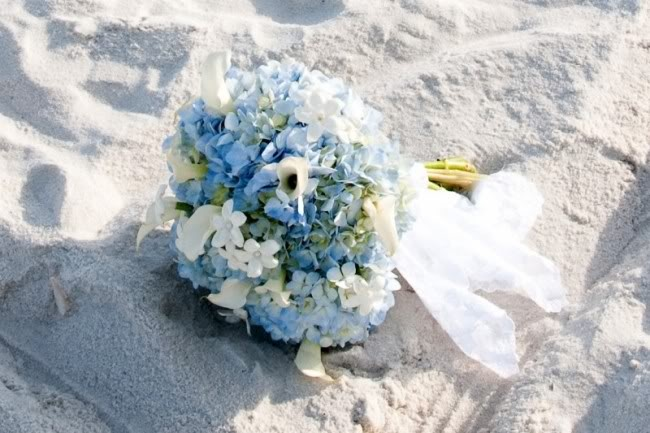 a beautiful white and blue wedding bouquet with a neutral and airy wrap for a beach bride