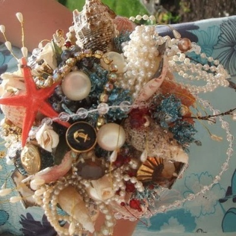 a bright wedding bouquet composed of seashells, star fish, pearls and beads looks very original and non-traditional