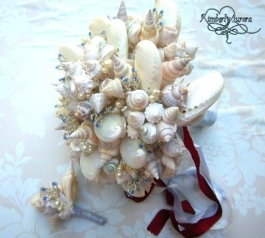 a chic seashell wedding bouquet with pearls and ribbons is a cool idea for a beach wedding