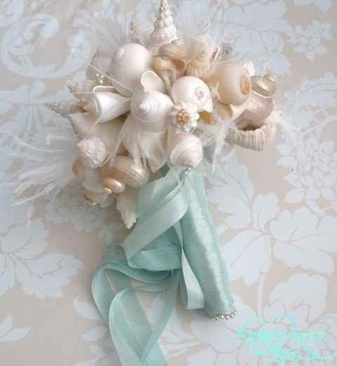 a beautiful seashell wedidng bouquet with feathers and turquoise ribbons is a chic idea for a beach wedding