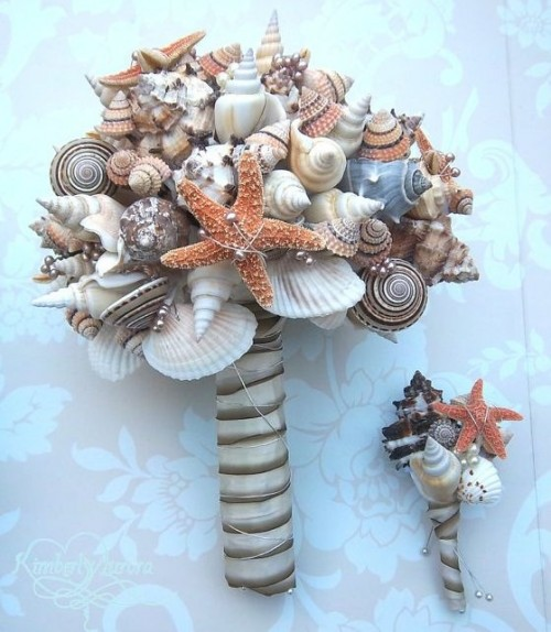 a non-traditional beach wedding bouquet of seashells, starfish and a simple ribbon wrap
