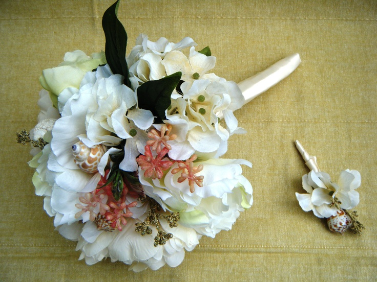 a beach wedding bouquet of neutral and pink blooms, with greenery touches