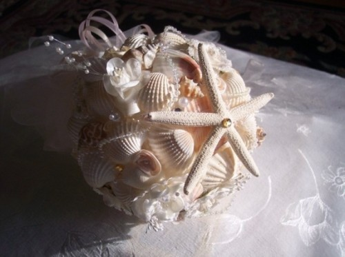 a ball seashell and starfish wedding bouquet for a beach wedding
