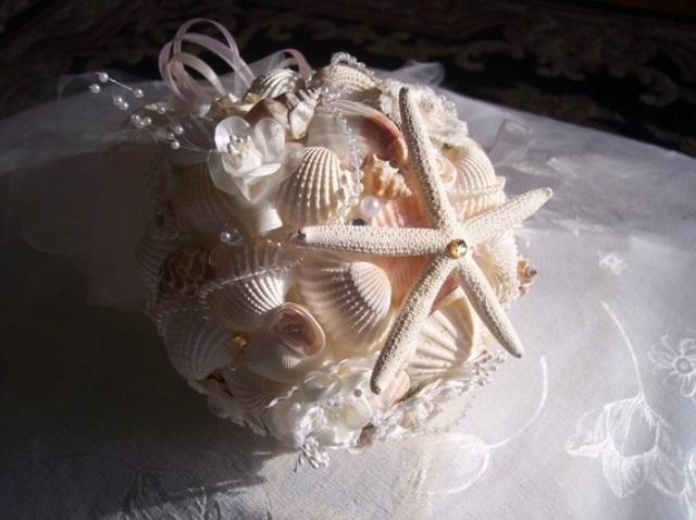 a ball seashell and starfish wedding bouquet for a beach wedding