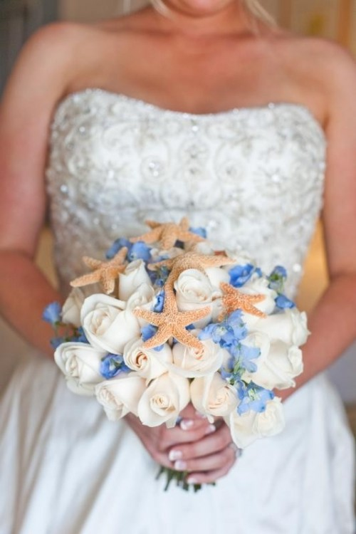 a blue and white wedding bouquet with starfish for a beach bride