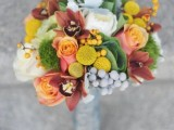 a catchy fall wedding bouquet of pink, white and dusty pink blooms, billy balls and various berries, greenery and even moss is a fun idea for the fall