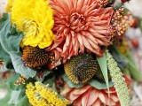 a colorful fall wedding bouquet of pink, yellow blooms and wildflowers, various greenery and leaves is a gorgeous idea for a relaxed fall wedding