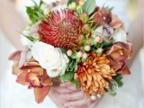 a bright wedding bouquet of pink, rust and white blooms, greenery and berries is a lovely idea for a simple fall wedding