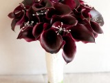 a deep purple callas wedidng bouquet with beads is a statement-like idea for a Halloween or fall wedding