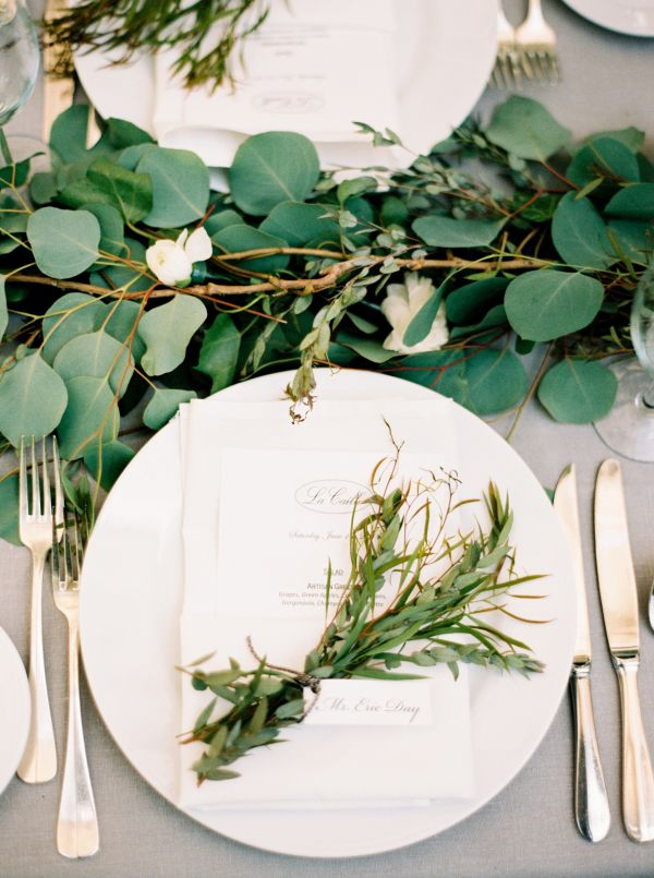a silver penny eucalyptus and white bloom table runner is a gorgeous idea