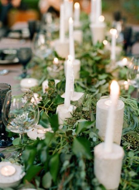 a super lush eucalyptus table runner, concrete candle holders and tall candles