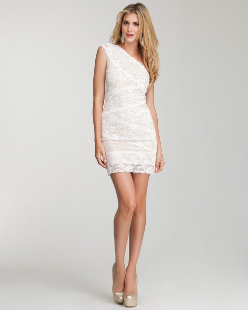 a white lace one shoulder mini dress is a classic option for a rehearsal dinner that fits any style and theme