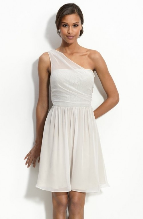 a neutral A-line short strapless dress with a sheer strap on one shoulder and a pleated skirt will match many styles