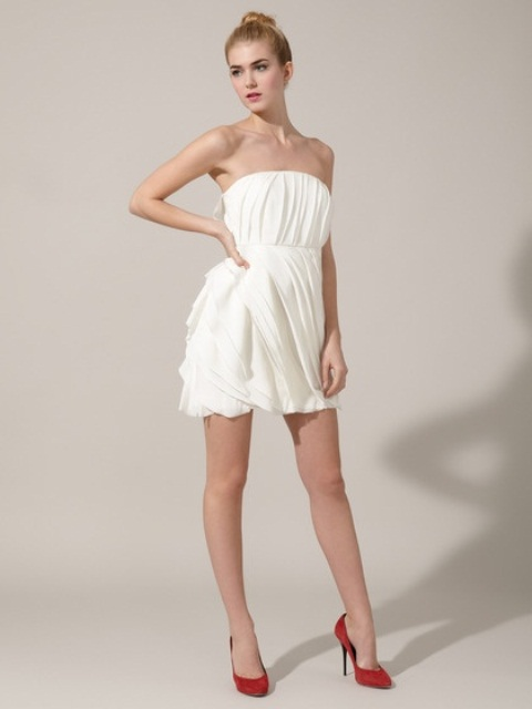 a strapless mini dress, all pleated and draped is a chic and sexy idea, pair it with bold shoes