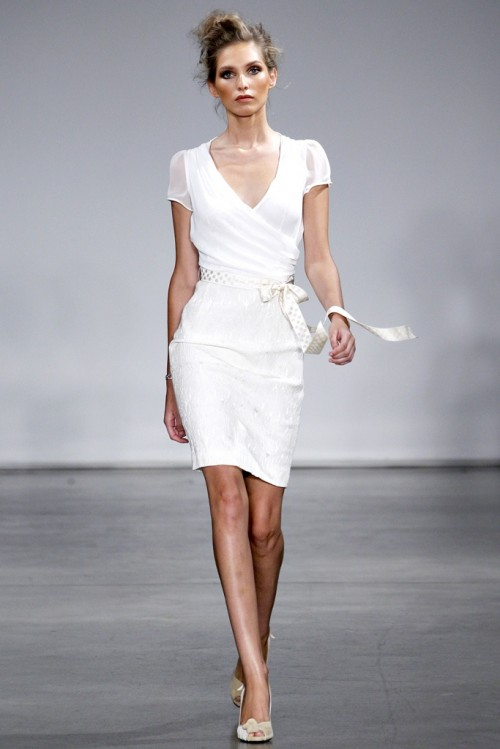 a stylish plain modern wrap dress with a draped bodice, short sleeves and an embellished skirt