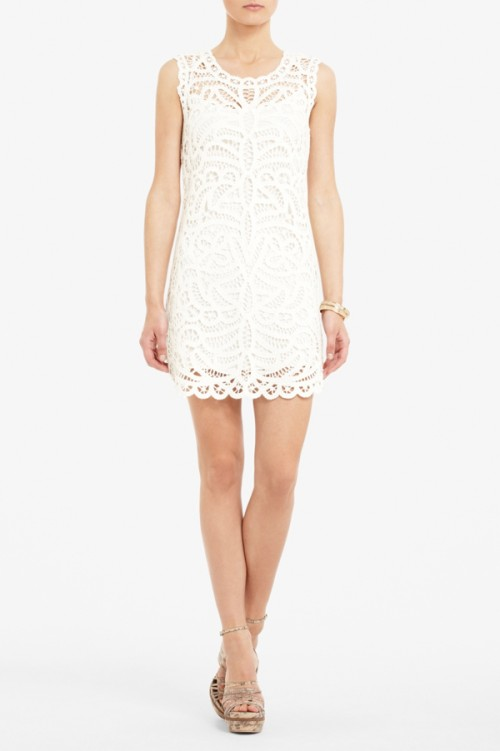 a white lace sleeveless mini dress is classics that always works and looks cool and stylish