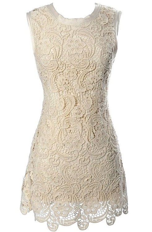 an ivory lace fitting mini dress is a chic and romantic idea to rock, it's always on trend