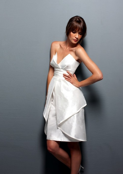 a gorgeous white strapless knee dress with a sculptural bodice and a layered skirt just wows