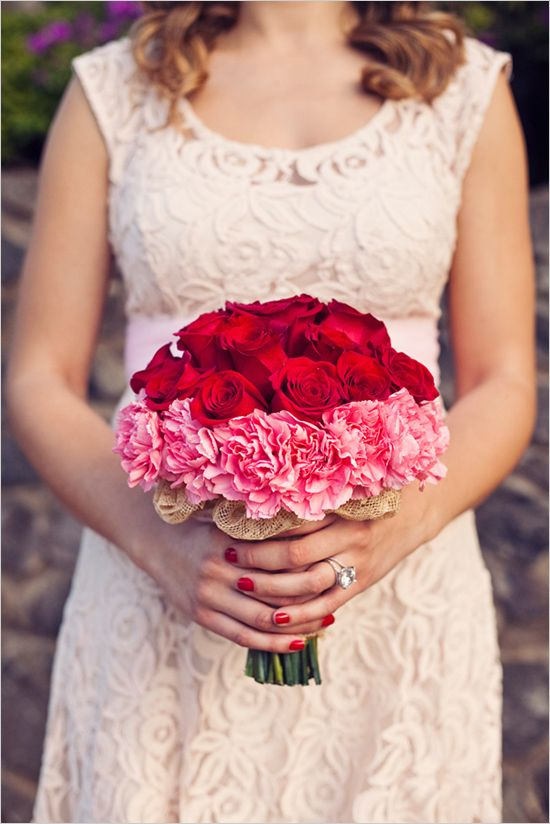 a bold red and pink wedding bouquet of roses and carnations is a statement idea for a Valentine's Day bride