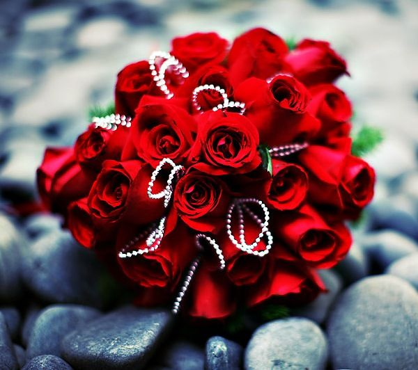a refined red rose wedding bouquet with rhinestones is a bold glam idea for a Valentine's Day bride