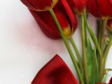 a simple red tulip wedding bouquet with a red ribbon bow is a lovely and elegant bouquet idea to rock at this romantic holiday