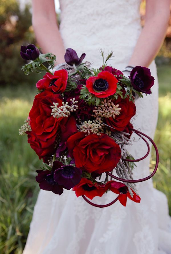 a refined red and deep purple wedding bouquet with greenery and pale greenery is a cool idea for a color loving bride