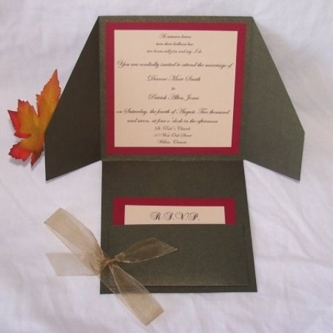 a dark green and burgundy wedding invitation suite with elegant calligraphy for a chic fall wedding