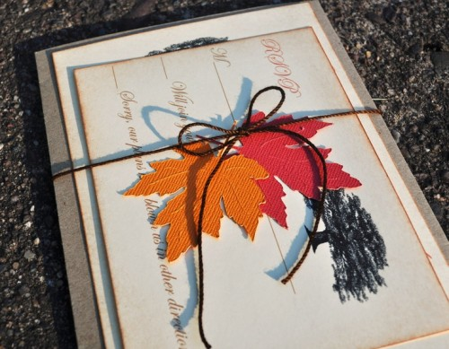 a chic and bright wedding invitation suite with bold fall leaves and a painted tree