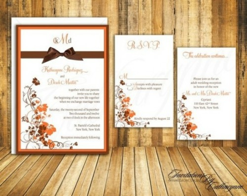 a vintage-inspired fall leaf wedding invitation suite with bright fal leaves and plants printed on it