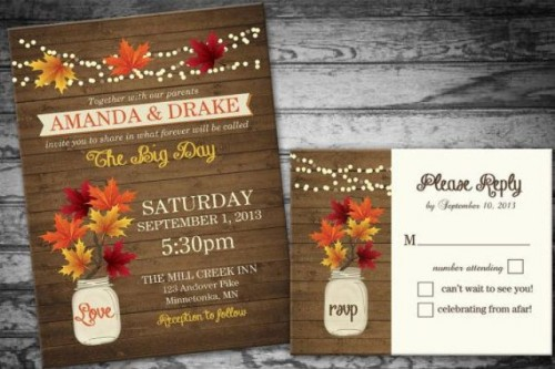 a rustic-inspired wedding invitation suite styled as a wooden plank invite, bright fall leaves and blooms printed on it