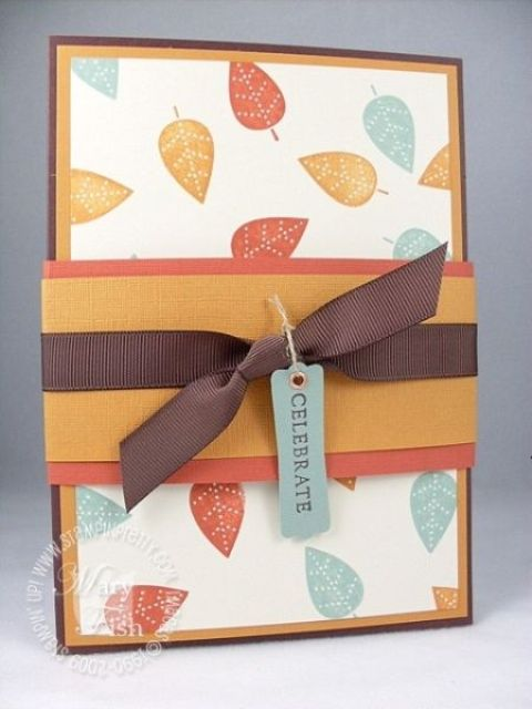 a bold fall wedding invitation with bright fall leaves and ties and a tag for the fall