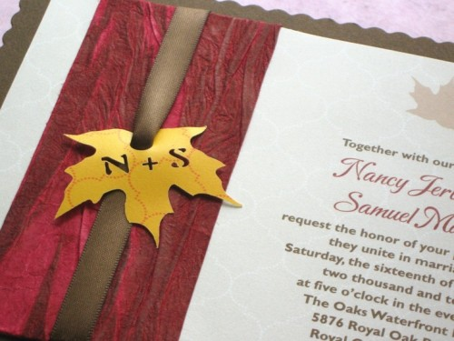 a chic wedding invitation suite done in burgundy, brown and with a tiny fall leaf