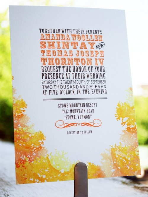 a bright fall wedding invitation with colorful letters and bold orange leaves printed on it