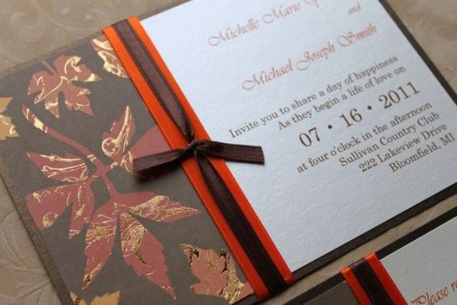 a dark fall wedidng invitation suite in chocolate brown, burgundy and orange with a ribbon and a bow